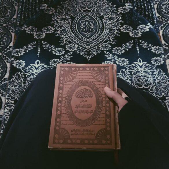 Muslim woman with Quran in her hands - (Credit: Majdah Nizam)